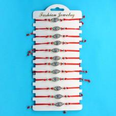 KNN010S Набор браслетов из красной нити со стразами Глаз Фатимы, 12шт, цвет серебр.